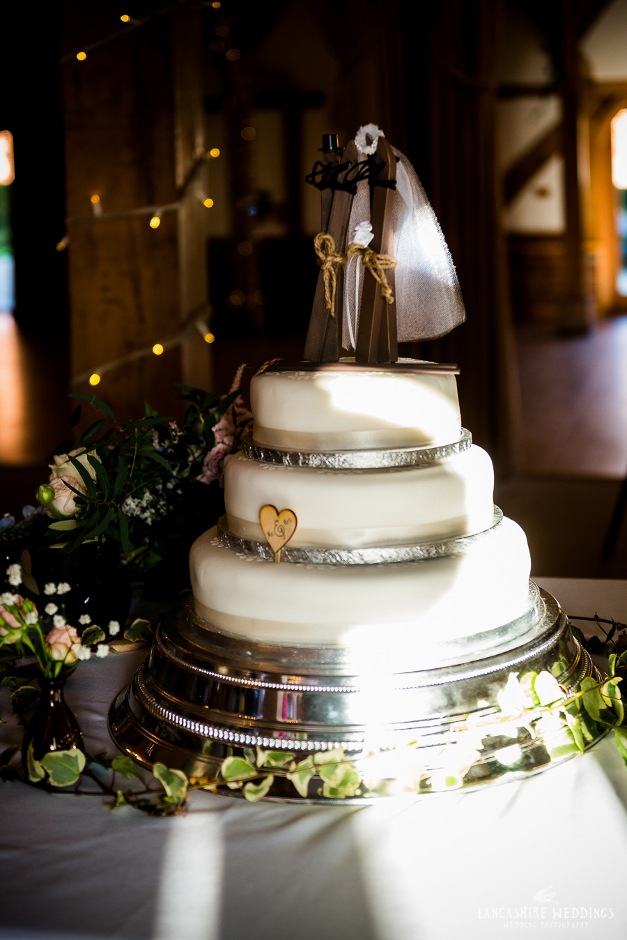 Wedding cake with ski's on top!