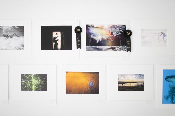 Inspired Gallery Event gallery wall with two ribboned images