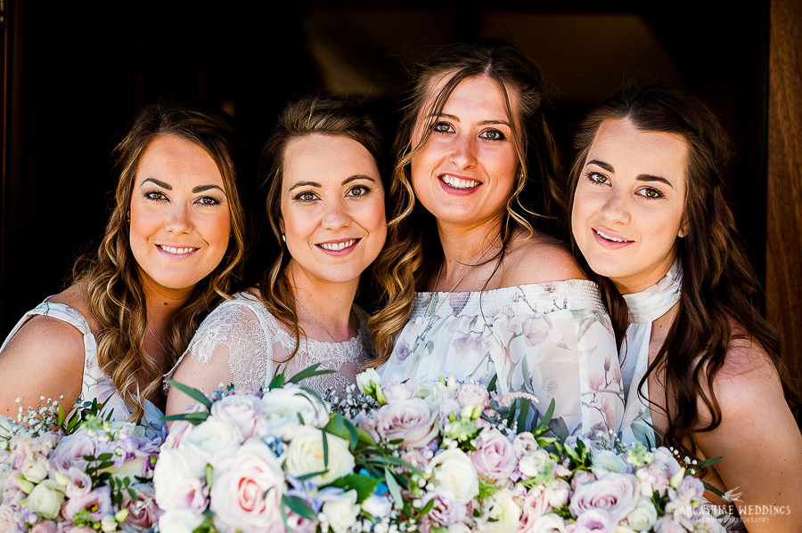 Bride and her maids group shot at Sandhole Oak Barn