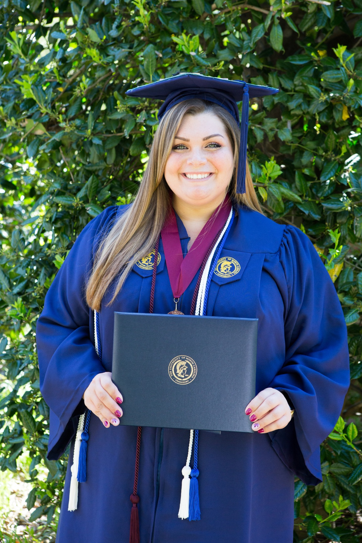 Unc Greensboro A Graduate Receives Her Diploma Elizabeth Larson