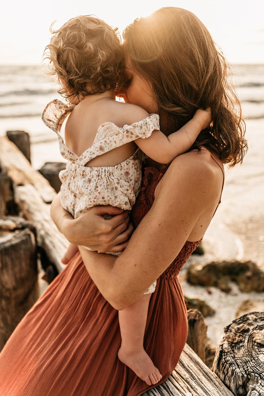 mother nuzzling baby girl, sunset beach photo session, Ryaphotos