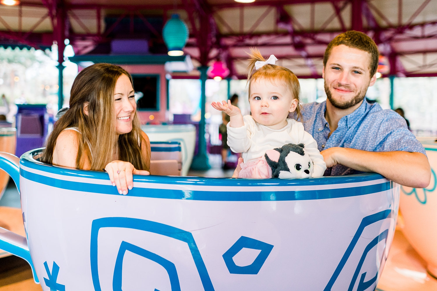 mom and dad with little girl, Disney World teacup ride, Magic Session, Rya Duncklee
